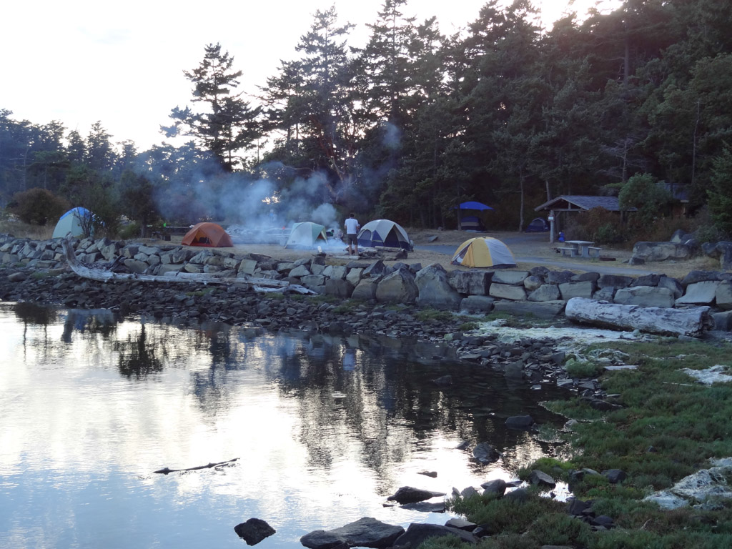 We set up camp in the group campsite that had a nice shelter and adirondack. It was right next to the water, but grass, no sand and rocks! Of course, where there are scouts and wood, there are fires!